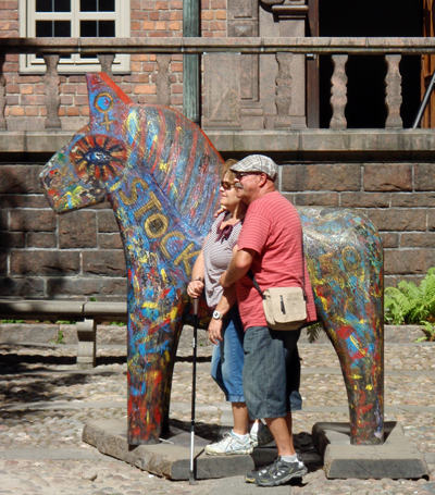 Old tourists and a wooden horse at Stockholm City Hall
