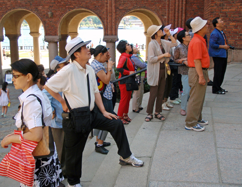 Japanese tourists have a look at Stockholm City Hall, Sweden