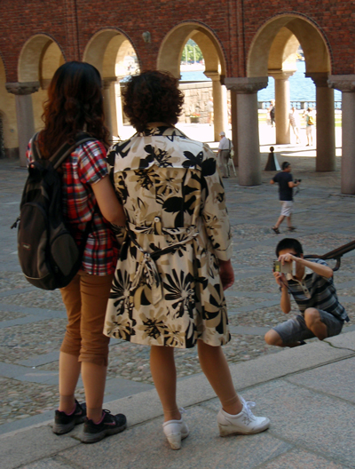 A Japanese tourist takes a photo of his mom and sis